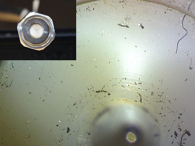 N-Connector under microscope. What seems to be a clean connector at a first glance, turns out to carry significant contaminated